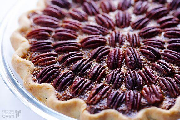 """<p>A classic pie is made all the more special when it's topped with rings of pecans. This one's just begging to be shared.</p><p><strong>Get the recipe at <a href=""""https://www.gimmesomeoven.com/best-pecan-pie-recipe/"""" target=""""_blank"""">Gimme Some Oven</a>. </strong></p><p><strong><a class=""""body-btn-link"""" href=""""https://www.amazon.com/gp/product/B07TLHYFPF?tag=syn-yahoo-20&ascsubtag=%5Bartid%7C10050.g.968%5Bsrc%7Cyahoo-us"""" target=""""_blank"""">SHOP PIE PLATES</a></strong></p>"""