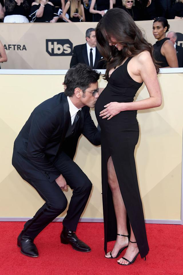 <p>At the Screen Actors Guild Awards, Stamos fawned all over his bride-to-be's pregnant belly, and McHugh loved it. Do you think they even realized that photographers were snapping away? (Photo: Frazer Harrison/Getty Images) </p>