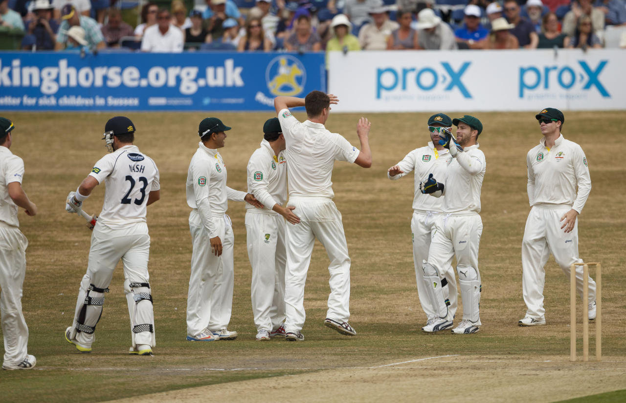 Sussex's Chris Nash walks after being caught by Australia's Steve Smith off Jackson Bird (centre) during day two of the international tour match against Australia at the BrightonandHoveJobs.com County Cricket Ground, Hove.