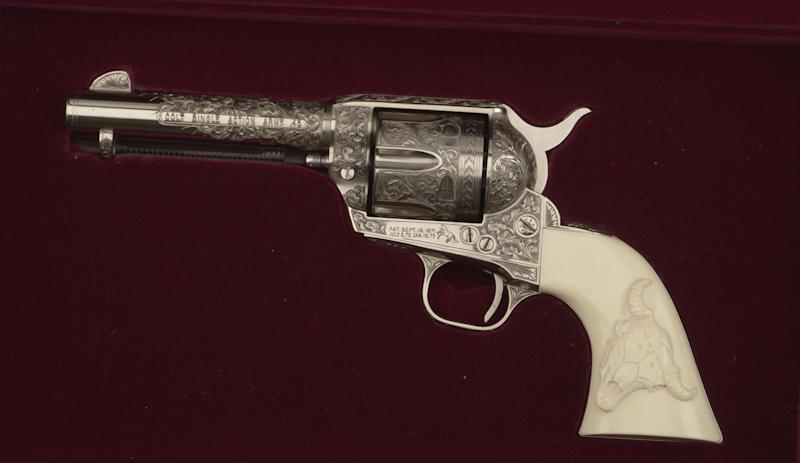 """This undated photo provided by the Buffalo Bill Center of the West in Cody, Wyo., shows the Colt .45 single-action revolver used by actor John Hart in the original """"The Lone Ranger"""" television series, which ran from 1952-1954. The museum has acquired the pistol made famous by the masked hero of television from more than 60 years ago. The revolver is now on display at the Buffalo Bill Center of the West, in Cody. Hart used several firearms over his acting career, but this gun is special. It features ivory grips and intricate engraving. (AP Photo/Buffalo Bill Center of the West)"""