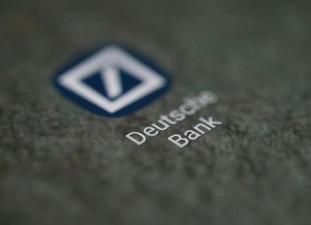 The Deutsche Bank app logo is seen on a smartphone in this illustration