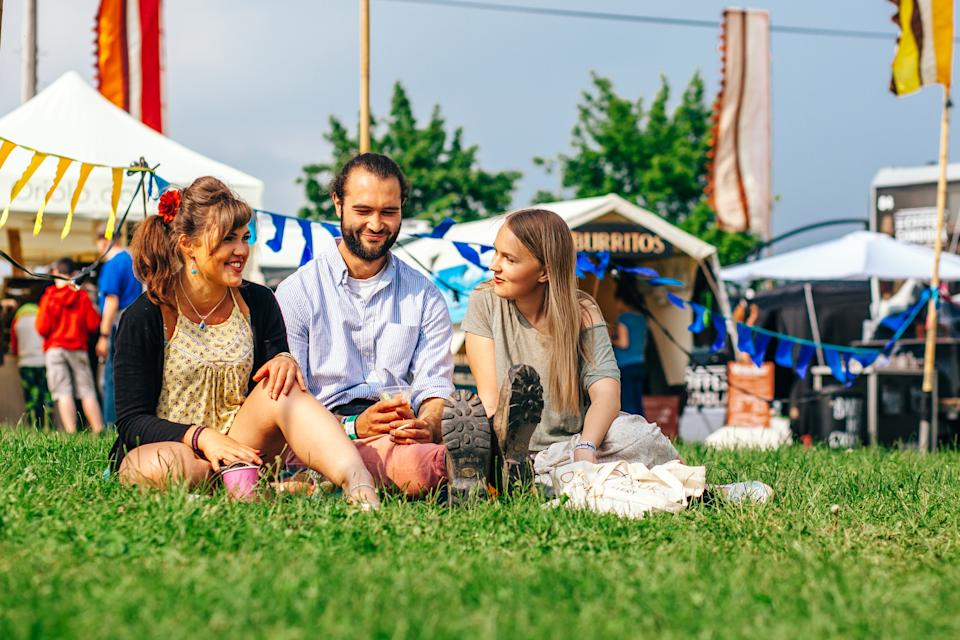 Festival goers chat at the real-life version of the experience