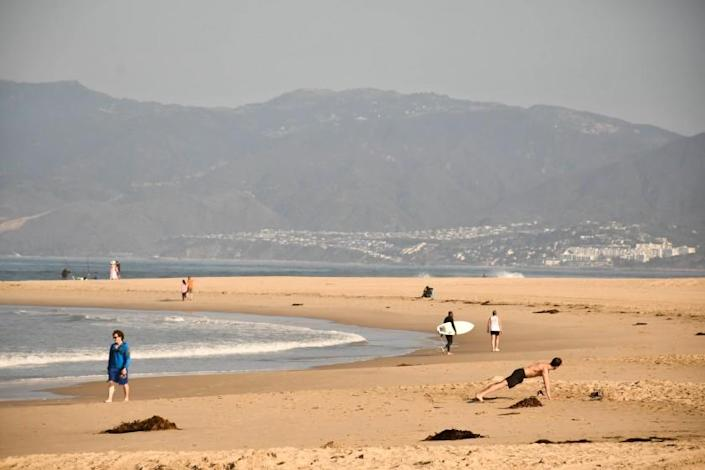 "L.A. County beaches, including Venice, shown here, will be closed for the July 4 weekend because of coronavirus transmission fears. Beaches in other parts of SoCal are expected to remain open, as are most parks. <span class=""copyright"">(Christopher Reynolds / Los Angeles Times)</span>"