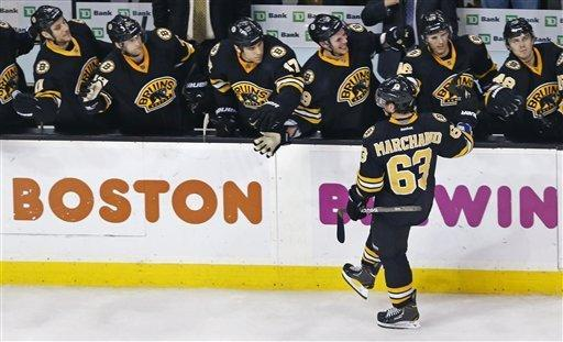 Boston Bruins left wing Brad Marchand (63) is congratulated by teammates after his goal against New Jersey Devils goalie Johan Hedberg in a shoot out following overtime of an NHL hockey game in Boston, Tuesday, Jan. 29, 2013. Marchand's goal put the Bruins ahead, giving them a 2-1 shoot out win. (AP Photo/Charles Krupa)