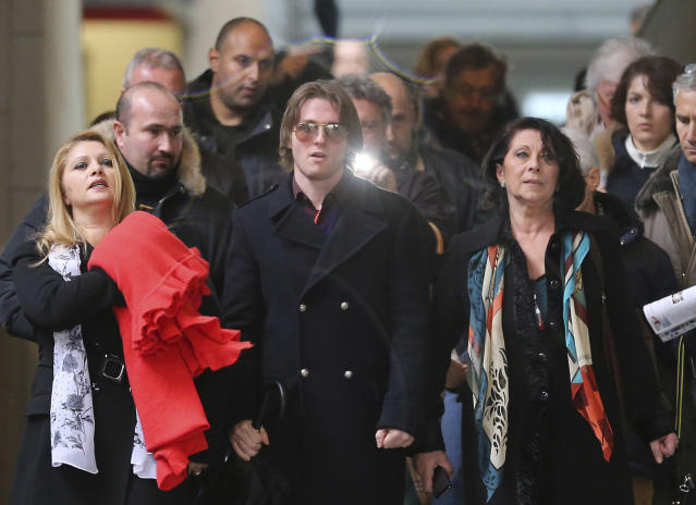 Raffaele Sollecito is flanked by his stepmother Mara Papagni, left, and his aunt Sara Achille, right, as he leaves after attending the final hearing before the third court verdict for the murder of British student Meredith Kercher, in Florence, Italy, Thursday, Jan. 30, 2014. The first two trials produced flip-flop verdicts of guilty then innocent for Kercher former roommate, American student Amanda Knox, who is not attending the hearing, and her former Italian boyfriend, Raffaele Sollecito, and the case has produced harshly clashing versions of events. A Florence appeals panel designated by Italy's supreme court to address issues it raised about the acquittal is set to deliberate Thursday, with a verdict expected later in the day. (AP Photo/Antonio Calanni)