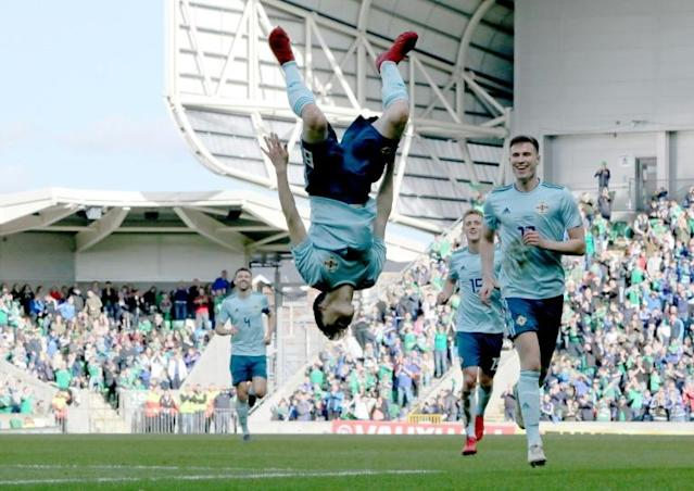 Northern Ireland's Paul Smyth (C) celebrates scoring his team's second goal during the international friendly football match between Northern Ireland and South Korea at at Windsor Park in Belfast (AFP Photo/Paul FAITH)