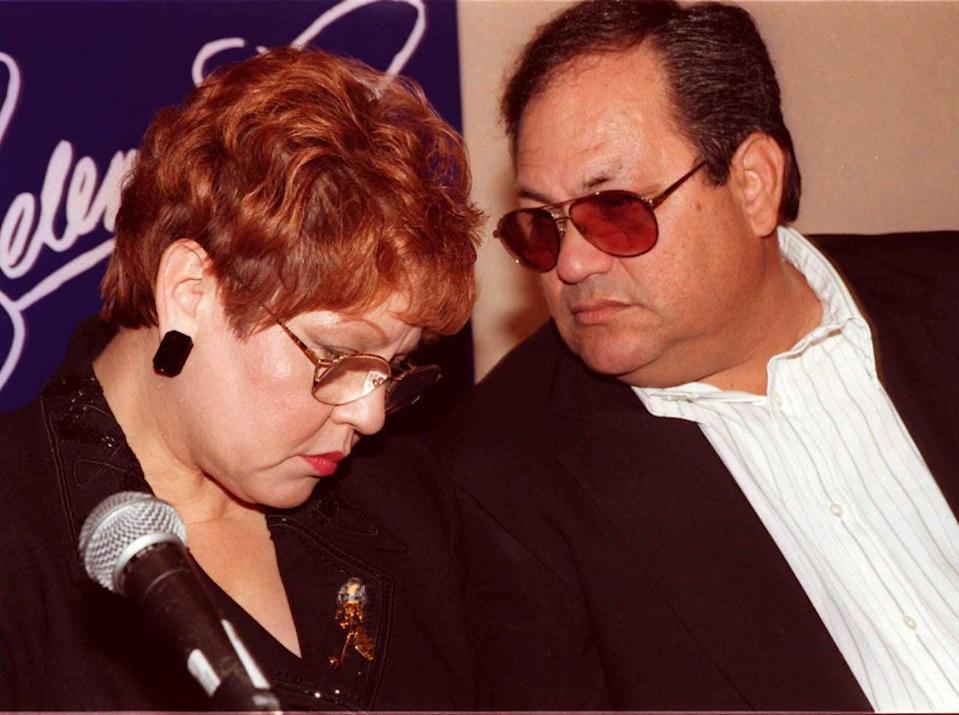 BEVERLY HILLS, UNITED STATES:  The parents of deceased Tejano singer Selena, Marcella and Abraham Quintanilla Jr. (R), confer at a press conference in Beverly Hills 18 June. The press conference was held to reveal the stars of the upcoming Warner Brothers Studio movie about Selena.  AFP PHOTO Tiziana SORGE (Photo credit should read TIZIANA SORGE/AFP via Getty Images)