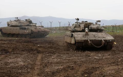 Israeli army Merkava tanks gather in the Israeli-annexed Golan Heights, - Credit: AFP