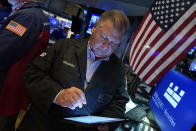 Trader George Ettinger works on the floor of the New York Stock Exchange, Wednesday, Sept. 22, 2021. Stocks rose broadly on Wall Street Wednesday ahead of an update from the Federal Reserve on how and when it might begin easing its extraordinary support measures for the economy. (AP Photo/Richard Drew)