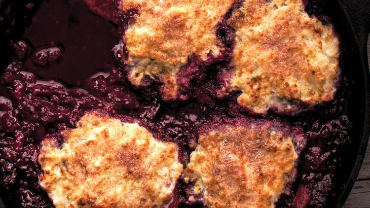 """<p>Think of a grunt as somewhere in between a fruit cobbler and crisp. The filling is made from cooked <a href=""""https://www.marthastewart.com/274895/60-berry-desserts"""" rel=""""nofollow noopener"""" target=""""_blank"""" data-ylk=""""slk:mixed berries"""" class=""""link rapid-noclick-resp"""">mixed berries</a>, sugar, and lemon juice, and is topped with buttermilk biscuit dough and sprinkled with cinnamon sugar. <a href=""""https://www.marthastewart.com/354916/skillet-cooked-mixed-berry-grunt"""" rel=""""nofollow noopener"""" target=""""_blank"""" data-ylk=""""slk:View recipe"""" class=""""link rapid-noclick-resp""""> View recipe </a></p>"""