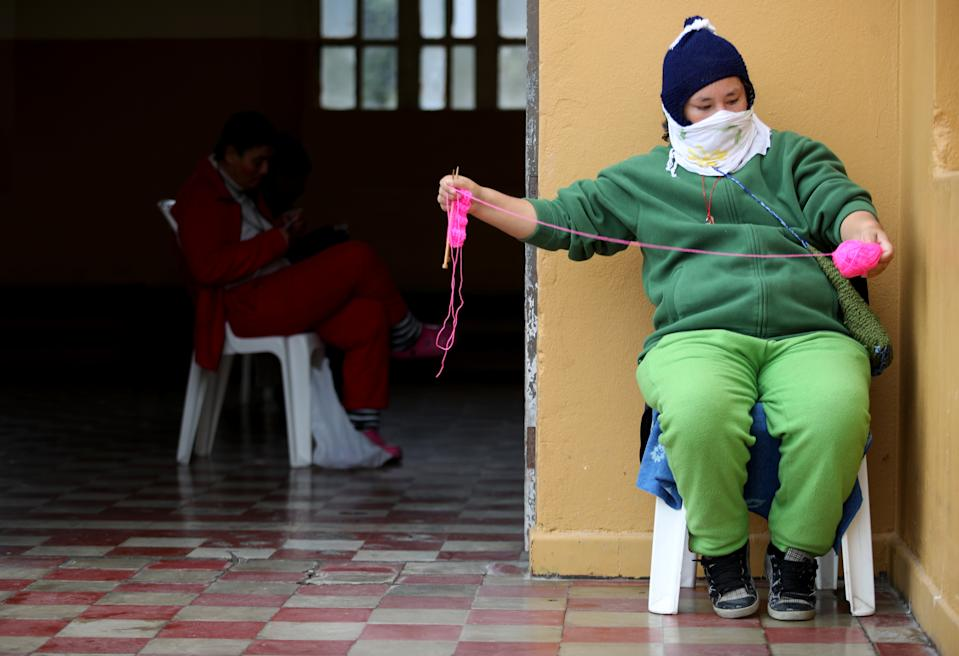 LIMA, PERU - JUNE 25: A patient knits a sweater at Victor Larco Herrera Mental Hospital on June 25, 2020 in Lima, Peru. Tests carried at the largest mental hospital in Peru confirmed that 162 of of 342 patients and 121 workers were infected with COVID-19. Authorities informed 95 patients have already recovered. Peru is the second worst-hit country in Latin America with 264.689 positive cases, only after Brazil. (Photo by Raul Sifuentes/Getty Images)