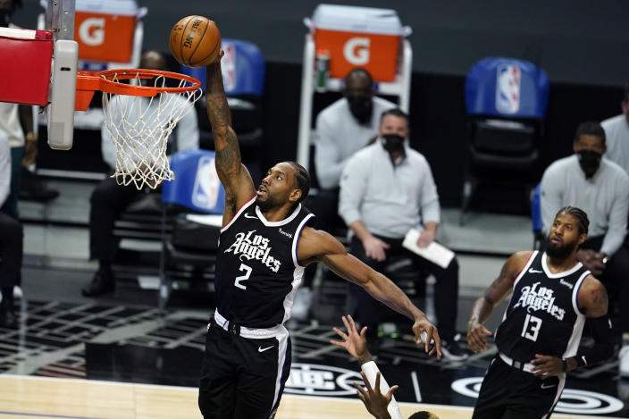 Los Angeles Clippers forward Kawhi Leonard dunks against the Los Angeles Lakers during the first half of an NBA basketball game Sunday, April 4, 2021, in Los Angeles. (AP Photo/Marcio Jose Sanchez)