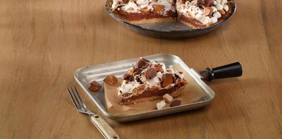 """<p>So it might be easier to make s'mores during your <a href=""""https://www.theactivetimes.com/how-to-backyard-campout?referrer=yahoo&category=beauty_food&include_utm=1&utm_medium=referral&utm_source=yahoo&utm_campaign=feed"""" rel=""""nofollow noopener"""" target=""""_blank"""" data-ylk=""""slk:backyard camping adventure"""" class=""""link rapid-noclick-resp"""">backyard camping adventure</a>, but this Butterfinger campfire pie made with Butterfinger candy bars will make you feel like you're sitting by the fire.</p> <p><a href=""""https://www.thedailymeal.com/recipe/butterfinger-smores-pie?referrer=yahoo&category=beauty_food&include_utm=1&utm_medium=referral&utm_source=yahoo&utm_campaign=feed"""" rel=""""nofollow noopener"""" target=""""_blank"""" data-ylk=""""slk:For the Butterfinger Campfire Pie recipe, click here."""" class=""""link rapid-noclick-resp"""">For the Butterfinger Campfire Pie recipe, click here.</a></p>"""