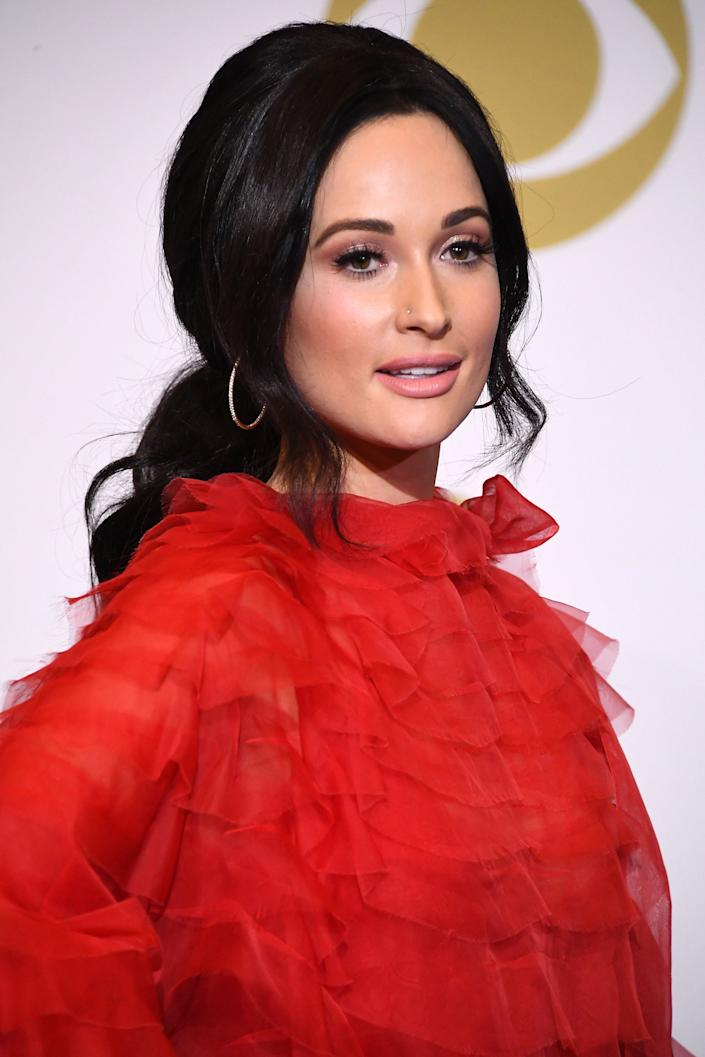 """<h3>Kacey Musgraves, 2019</h3><br>Long ponytails <a href=""""https://www.refinery29.com/en-us/2019/02/224047/long-ponytail-hair-trend-grammys-2019"""" rel=""""nofollow noopener"""" target=""""_blank"""" data-ylk=""""slk:were trending at the 2019 Grammys"""" class=""""link rapid-noclick-resp"""">were trending at the 2019 Grammys</a>, but we're awarding Kacey Musgraves the win for her Dolly Parton-inspired version. <span class=""""copyright"""">Photo: Steve Granitz/WireImage.</span>"""