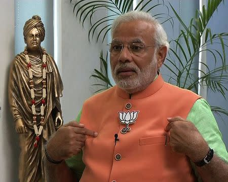 Narendra Modi, the prime ministerial candidate for Bharatiya Janata Party (BJP), speaks during an interview with the ANI television service at Gandhinagar in Gujarat in this still image taken from video April 16, 2014. REUTERS/ANI/Handout via Reuters