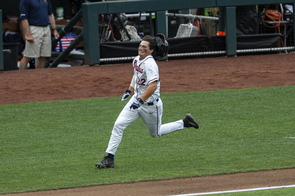 Virginia infielder Jake Gelof (22) scores in the second inning from a Chris Newell, not pictured double during a baseball game in the College World Series against Mississippi State Tuesday, June 22, 2021, at TD Ameritrade Park in Omaha, Neb. (AP Photo/John Peterson)