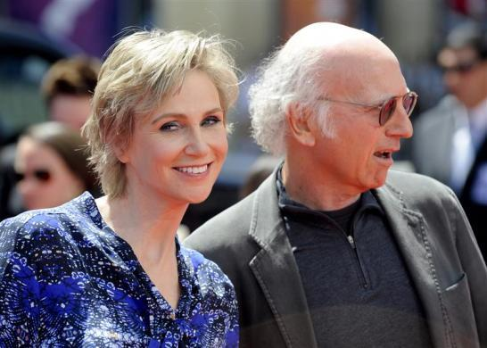 "Jane Lynch and Larry David arrive at the Hollywood premiere of ""The Three Stooges: The Movie"" in Los Angeles, April 7, 2012."