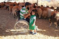 Seriously wounded in the revolt that overthrew and killed dictator Moamer Kadhafi in 2011, Osama al-Aqury uses a wheelchair as he manoeuvres easily among his animals