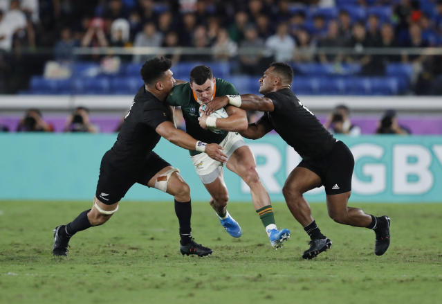 South Africa's Jesse Kriel is tackled by New Zealand players during the Rugby World Cup Pool B game between New Zealand and South Africa in Yokohama, Japan, Saturday, Sept. 21, 2019. (AP Photo/Shuji Kajiyama)