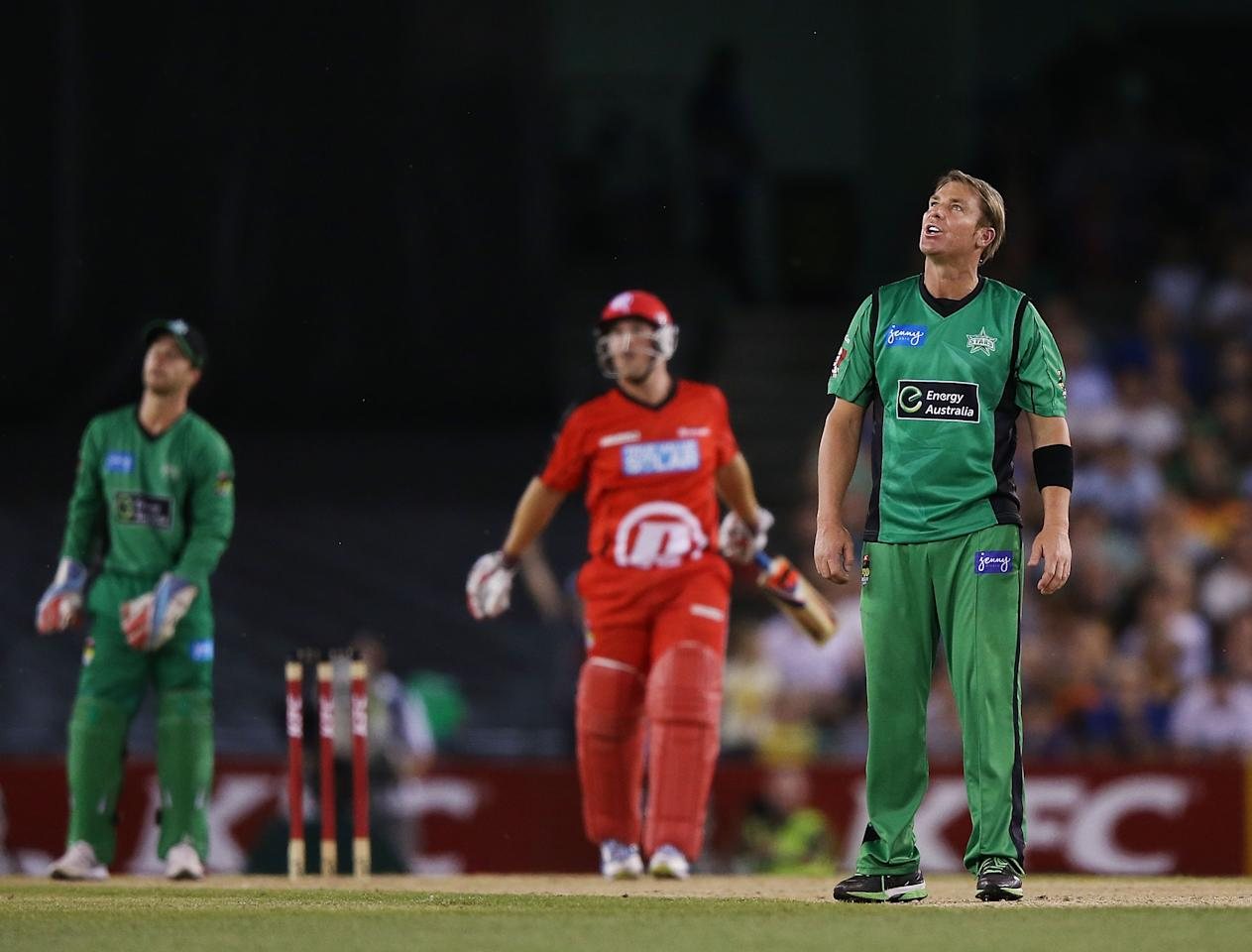 MELBOURNE, AUSTRALIA - DECEMBER 07:  Shane Warne of The Stars is hit for six by Aaron Finch of The Renegades during the Big Bash League match between the Melbourne Renegades and the Melbourne Stars at Etihad Stadium on December 7, 2012 in Melbourne, Australia.  (Photo by Michael Dodge/Getty Images)