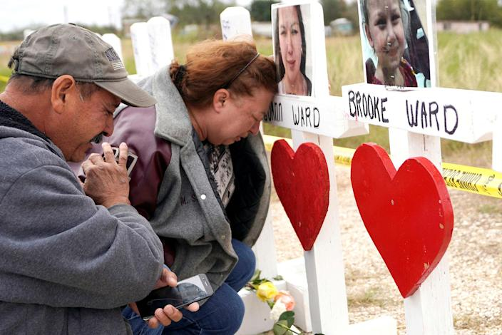 <p>NOV. 9, 2017 – Lorenzo Flores (L) and Terrie Smith react at a line of crosses in remembrance of those killed in the shooting at the First Baptist Church of Sutherland Springs, Texas. (Photo: Rick Wilking/Reuters) </p>