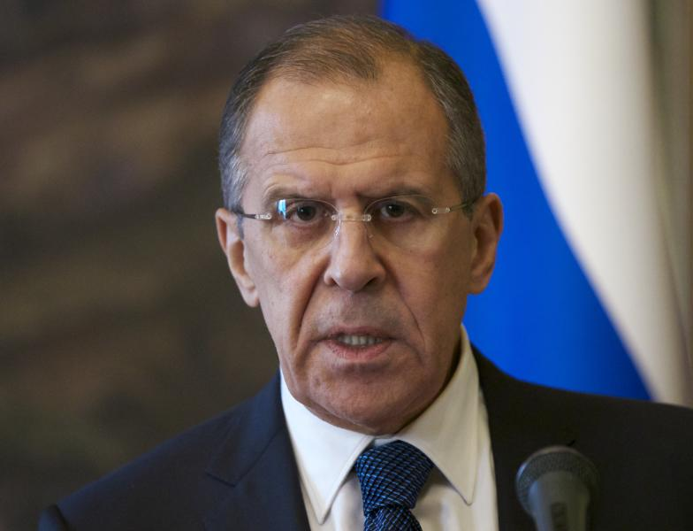 Russian Foreign Minister Sergey Lavrov speaks to the media after his talks with OSCE Secretary General Lamberto Zannier in Moscow, Russia, Friday, Nov. 8, 2013. Russia's Foreign Ministry says Syria's main Western-backed opposition group is refusing to participate in talks in Moscow. (AP Photo/Alexander Zemlianichenko)