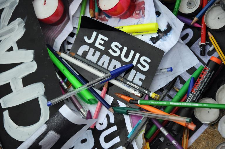 Pens and signs reading 'I am Charlie'' in La Rochelle during a gathering to pay tribute to the victims of the Paris shootings