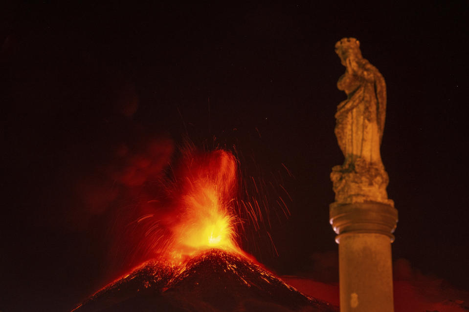 Lava erupts from Mt. Etna volcano during its sixteenth eruption since the volcanic activity started on Feb. 16, 2021, as seen from the northeast side of the volcano, near Fornazzo, in province of Catania, Sicily, southern Italy, early Wednesday, March 24, 2021. (AP Photo/Salvatore Allegra)