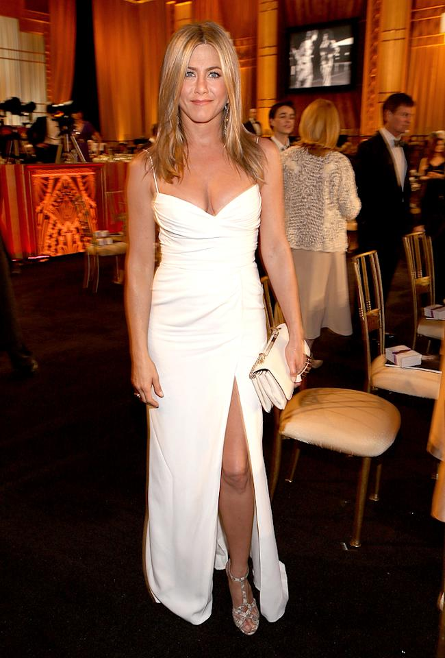 Even if you happen to be Team Jolie (like myself), there's no denying that Jennifer Aniston was a vision in white at the 40th AFI Lifetime Achievement Awards, which honored Shirley MacLaine late last week. Her Burberry dress was quite basic, but the 43-year-old looked alluring in the simple-yet-chic item ... and her snakeskin Tabitha Simmons heels. (6/7/2012)