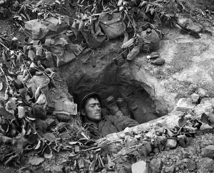 An American GI asleep in a trench in Normandy, France. (Photo: Three Lions/Getty Images)