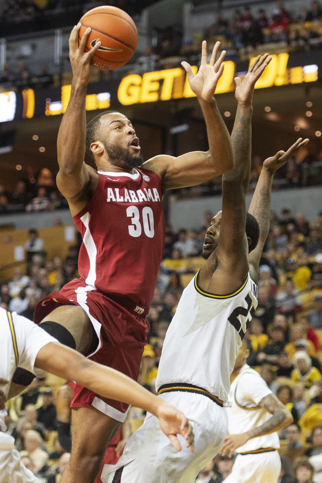 Alabama's Galin Smith, left, shoots over Missouri's Jeremiah Tilmon, left, during the first half of an NCAA college basketball game Saturday, March 7, 2020, in Columbia, Mo. (AP Photo/L.G. Patterson)