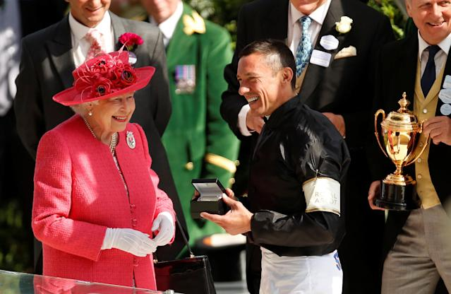 REFILE - CORRECTING TYPO Horse Racing - Royal Ascot - Ascot Racecourse, Ascot, Britain - June 21, 2018 Britain's Queen Elizabeth presents Frankie Dettori with a medal for winning the 4.20 Gold Cup riding Stradivarius Action Images via Reuters/Andrew Boyers