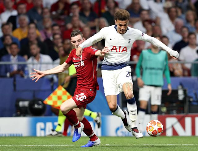 Andy Robertson vyes for possession with Dele Alli (Photo by Tottenham Hotspur FC/Tottenham Hotspur FC via Getty Images)