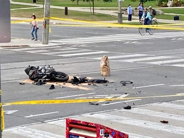 A motorcyclist is dead after his vehicle collided with a police vehicle at College Street and University Avenue on Friday. (Mehrdad Nazarahari/CBC - image credit)