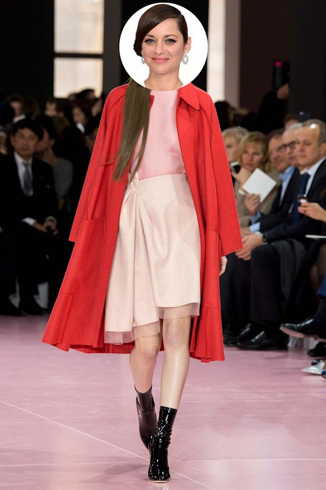 Marion Cotillard epitomizes French style and this prim pink dress topped with bright red coat and paired with edgy heels Parisian effortlessness combined with cool couture to a tee.