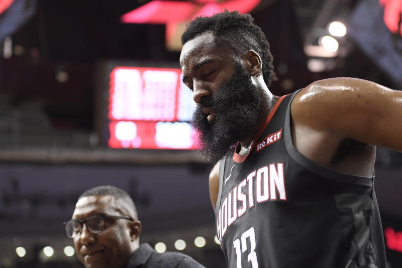 Houston Rockets guard James Harden (13) leaves the court after he was injured against the Toronto Raptors during second half NBA action in Toronto on Thursday, Dec. 5, 2019. (Nathan Denette/The Canadian Press via AP)