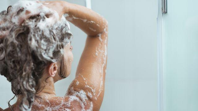 "Q&A With Dr. Manny: ""I've read that my hair will be healthier if I stop shampooing it every day. Is this true? And what about using dry shampoo?"""