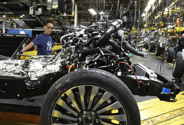 FILE – In this Oct. 27, 2017 file photo, workers assemble Ford trucks at the Ford Kentucky Truck Plant in Louisville, Ky. (AP Photo/Timothy D. Easley, File)