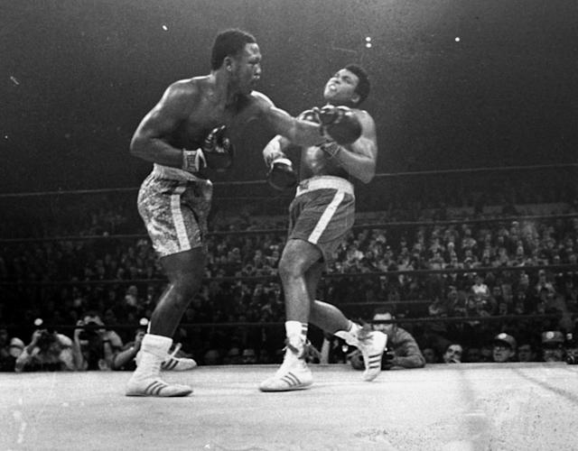 FILE - In this March 8, 1971, file photo, boxer Joe Frazier, left, hits Muhammad Ali during the 15th round of their heavyweight title fight at New York's Madison Square Garden.