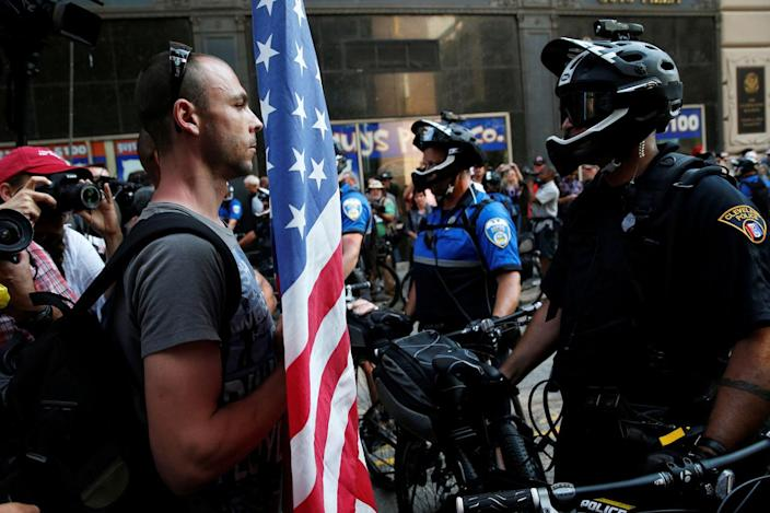<p>A demonstrator faces a police officer during protests outside the Republican National Convention in Cleveland on July 19, 2016. (Photo: Andrew Kelly/Reuters)</p>