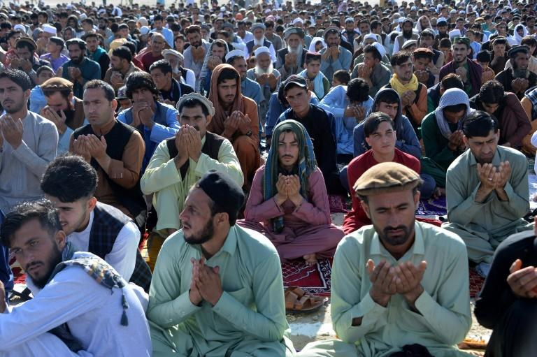 Muslims pray to start the Eid-al-Fitr festival at a mosque on the outskirts of Jalalabad