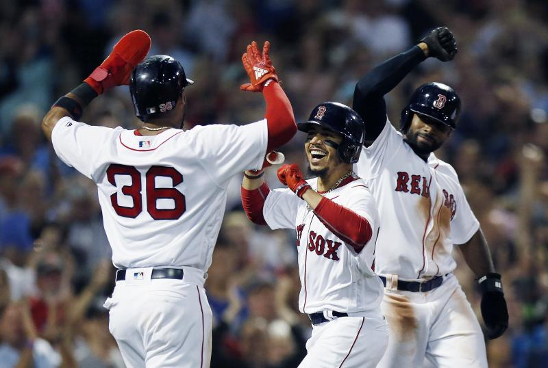 Boston Red Sox's Mookie Betts, center, celebrates his grand slam that also drove in Eduardo Nunez (36) and Jackie Bradley Jr., right, during the fourth inning of a baseball game against the Toronto Blue Jays in Boston, Thursday, July 12, 2018. (AP Photo/Michael Dwyer)