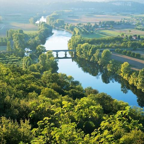A view of river and fields in Dordogne - Credit: Gary Yeowell/Getty