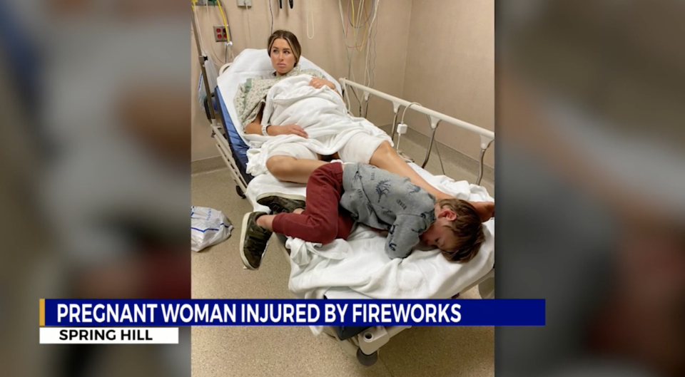A pregnant Katie Bihl shielded her three-year-old son from the firework. Source: WKRN