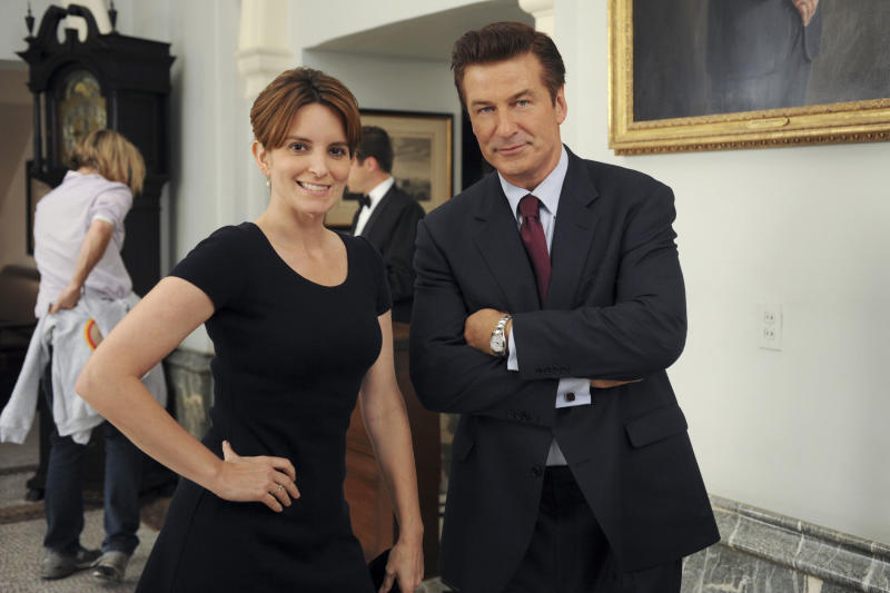 "30 ROCK -- ""Unwindulax"" Episode 704 -- Pictured: (l-r) Tina Fey as Liz Lemon, Alec Baldwin as Jack Donaghy -- (Photo by: Ali Goldstein/NBCU Photo Bank/NBCUniversal via Getty Images via Getty Images)"