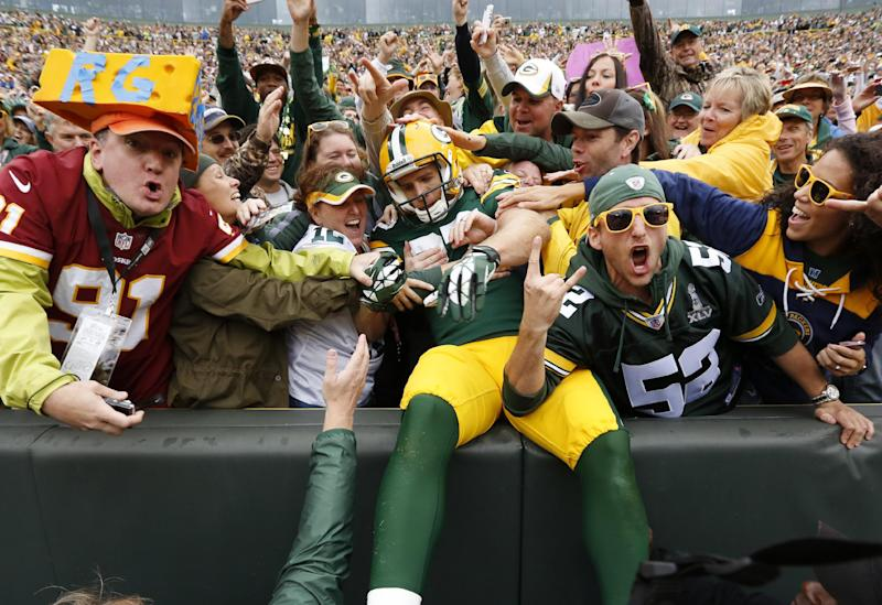 Green Bay Packers' Jordy Nelson celebrates with fans after a touchdown catch during the first half of an NFL football game against the Washington Redskins Sunday, Sept. 15, 2013, in Green Bay, Wis. (AP Photo/Mike Roemer)
