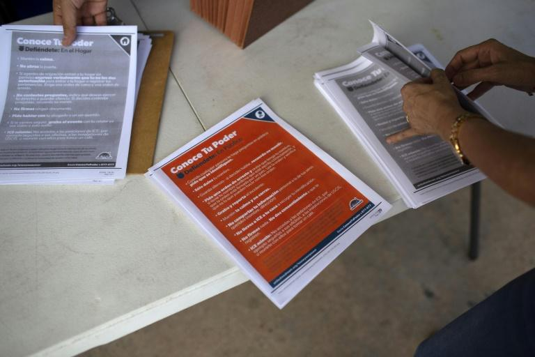 Immigration advocates with the Florida Immigrant Coalition prepare documents about migrant rights for delivery to houses in Miami's Little Havana on July 13, 2019 ahead of nationwide raids expected to target about 2,000 undocumented migrants