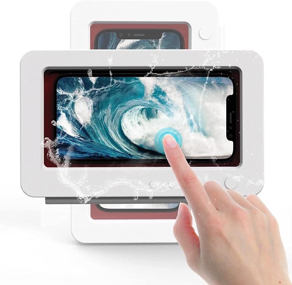 <p>If they love listening to music or catching up on podcasts and their favorite TV shows, they can now do it in the shower with the <span>Wall Mount Shower Phone Holder</span> ($14). It keeps their phone waterproof and let's them rotate their phone in any direction. The holder has an anti-fog screen that lets them use their phone normally.</p>