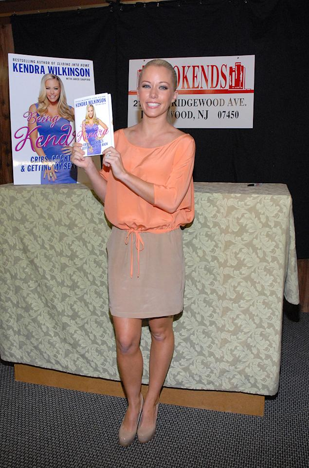 "Playboy playmate, Hugh Heffner's girlfriend, reality star, NFL wife, and now ... author! Across the Hudson River, Kendra Wilkinson made an appearance at a bookstore in Ridgewood, N.J., to sign copies of her memoir, <i>Being Kendra</i>, for her fans. Michael N. Todaro/<a href=""http://www.gettyimages.com/"" target=""new"">GettyImages.com</a> -"