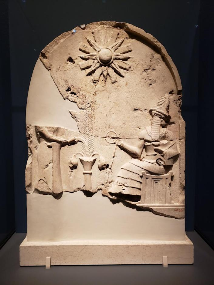 Fragments of limestone containing a bas-relief depiction of a god.